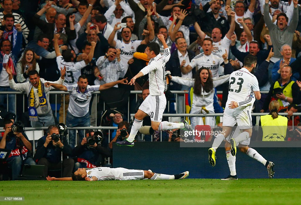 Javier Hernandez of Real Madrid CF (L) celebrates with fans and team mates as he scores their first goal during the UEFA Champions League quarter-final second leg match between Real Madrid CF and Club Atletico de Madrid at Bernabeu on April 22, 2015 in Madrid, Spain.