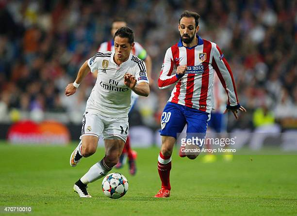 Javier Hernandez of Real Madrid CF is chased by Juanfran of Atletico Madrid during the UEFA Champions League quarterfinal second leg match between...
