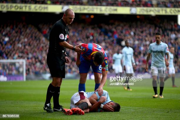 Javier Hernandez of West Ham lays injured during the Premier League match between Crystal Palace and West Ham United at Selhurst Park on October 28...