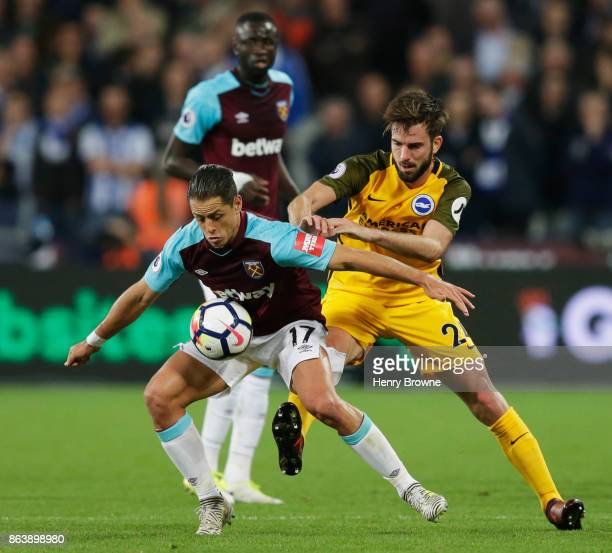 Javier Hernandez of West Ham United holds off Davy Propper of Brighton and Hove Albion during the Premier League match between West Ham United and...