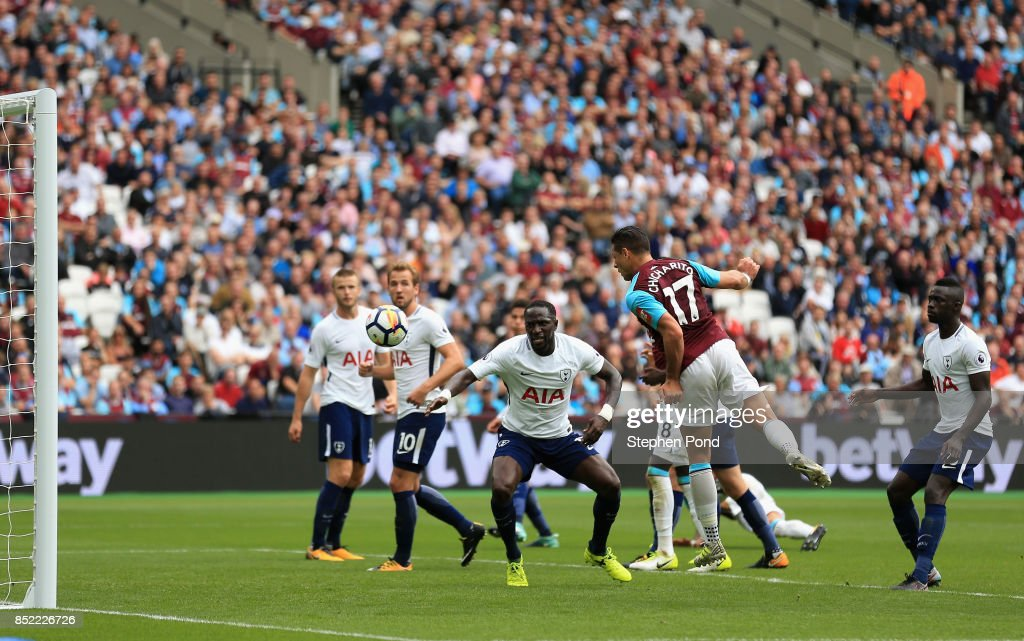 Javier Hernandez of West Ham United scores his sides first goal during the Premier League match between West Ham United and Tottenham Hotspur at London Stadium on September 23, 2017 in London, England.