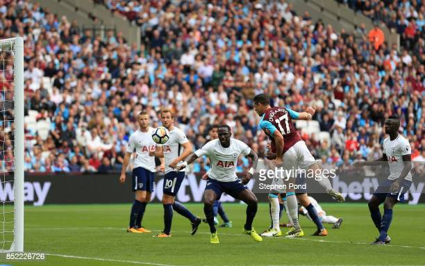 Javier Hernandez of West Ham United scores his sides first goal during the Premier League match between West Ham United and Tottenham Hotspur at...