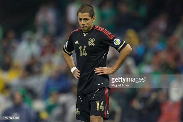 Javier Hernandez reacts after loosing against Honduras during a match between Mexico and Honduras as part of the 15th round of the South American...