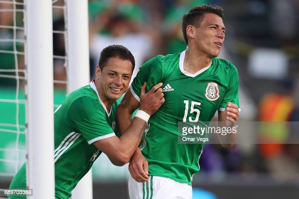 Javier Hernandez reacts after scoring with Hector Moreno of Mexico during an International Friendly match between Mexico and Croatia at Los Angeles...