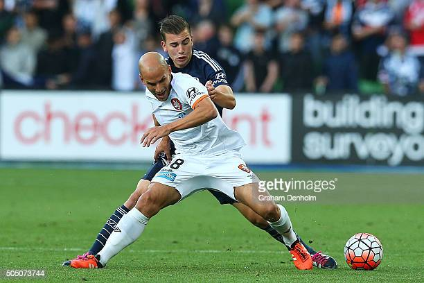 Javier Hervas of Brisbane Roar and Dylan Murnane of Melbourne Victory contest the ball during the round 15 ALeague match Melbourne Victory and...