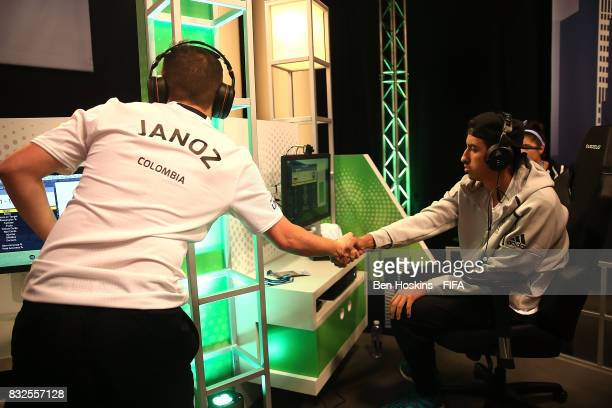 Javier 'Janoz' Munoz of Columbia and Fouad 'Rafsou' Fares of France shake hands following their game during day one of the FIFA Interactive World Cup...