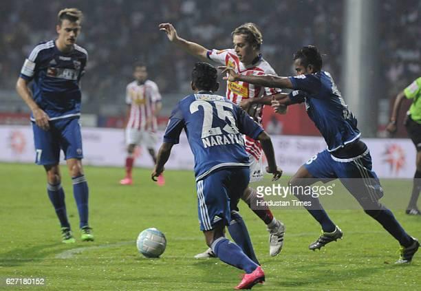 Javier Lara Grande of ATK Kolkata is being blocked by the defenders of Fc Pune City at Rabindra Sarobar stadium on December 2 2016 in Kolkata India