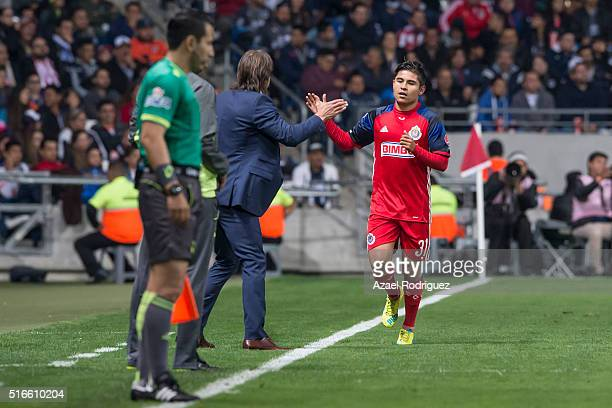 Javier Lopez of Chivas celebrate with coach Matias Almeyda after scoring his team's third goal during the 11th round match between Monterrey and...