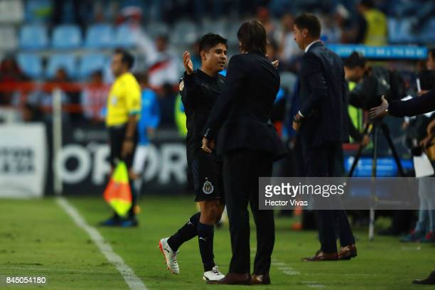 Javier Lopez of Chivas celebrates with his coach Matias Almeyda after scoring the second goal of his team during the 8th round match between Pachuca...