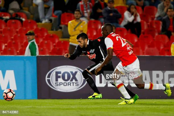 Javier Lopez of Santa Fe and Antonio Bareiro of Libertad compete for the ball during a second leg match between Independiente Santa Fe and Libertad...