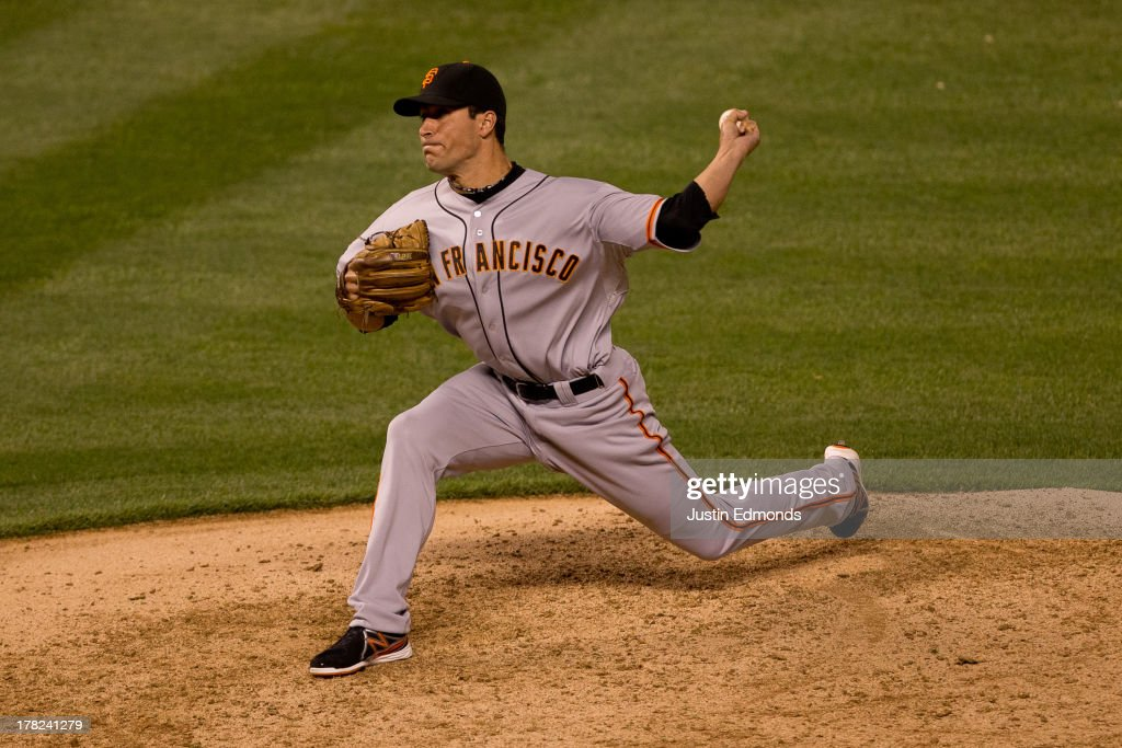 Javier Lopez #49 of the San Francisco Giants delivers to home plate during the eighth inning against the Colorado Rockies at Coors Field on August 27, 2013 in Denver, Colorado. The Giants defeated the Rockies 5-3.