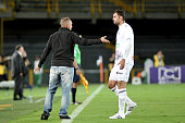 Javier Luis Torrente coach of Once Caldas gives instructions to his player during a match between Millonarios and Once Caldas as part of round 11 of...