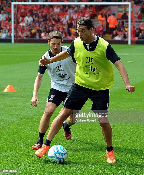 Javier Manquillo and Joe Allen of Liverpool in action during a training session at Anfield on August 8 2014 in Liverpool England
