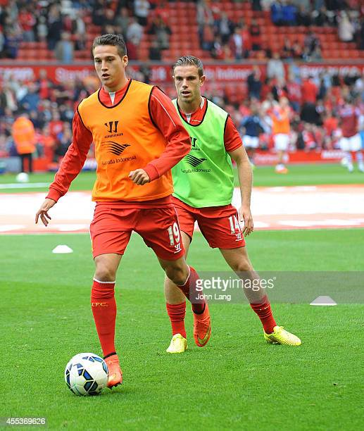 Javier Manquillo and Jordan Henderson of Liverpool warm up before the Barclays Premier League match between Liverpool and Aston Villa at Anfield on...