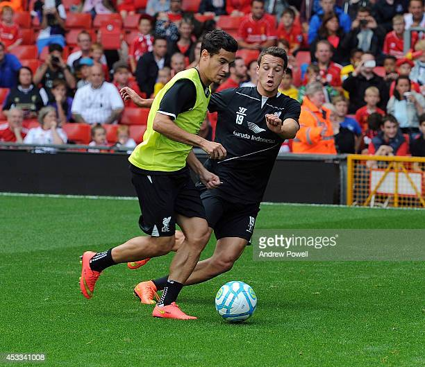 Javier Manquillo and Philippe Coutinho of Liverpool in action during a training session at Anfield on August 8 2014 in Liverpool England