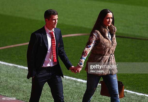 Javier Manquillo of Liverpool and partner arrive for the Barclays Premier League match between Liverpool and Manchester United at Anfield on March 22...