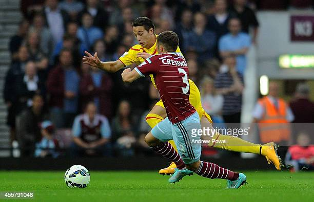 Javier Manquillo of Liverpool competes with Aaron Cresswell of West Ham United during the Barclays Premier League match between West Ham United and...