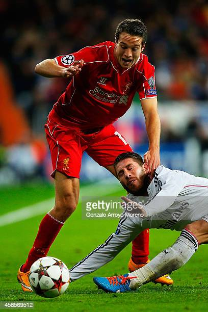 Javier Manquillo of Liverpool FC hangs Sergio Ramos of Real Madrid CF during the UEFA Champions League Group B match between Real Madrid CF and...