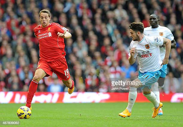 Javier Manquillo of Liverpool runs past Robbie Brady of Hull City during the Barclays Premier League match between Liverpool and Hull City at Anfield...