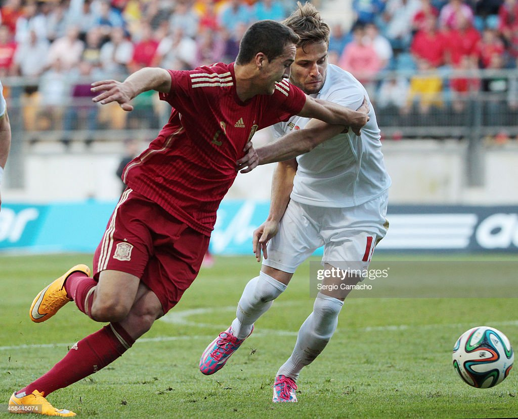 Javier Spain  city images : Javier Manquillo of Spain duels for the ball with Marko Petkovic of ...