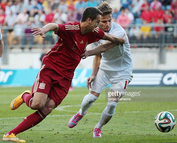 Javier Manquillo of Spain duels for the ball with Marko Petkovic of Serbia the UEFA European Under21 Championship playoff second leg match between...