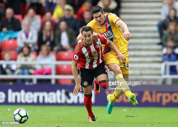 Javier Manquillo of Sunderland and Martin Kelly of Crystal Palace battle for the ball during the Premier League match between Sunderland and Crystal...