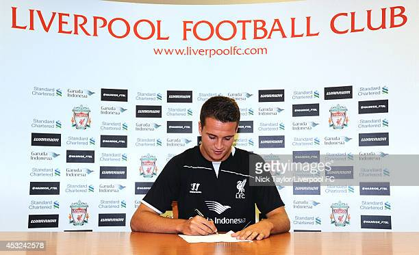 Javier Manquillo poses as he is unveiled as a new signing for Liverpool Football Club at Melwood Training Ground on August 5 2014 in Liverpool England