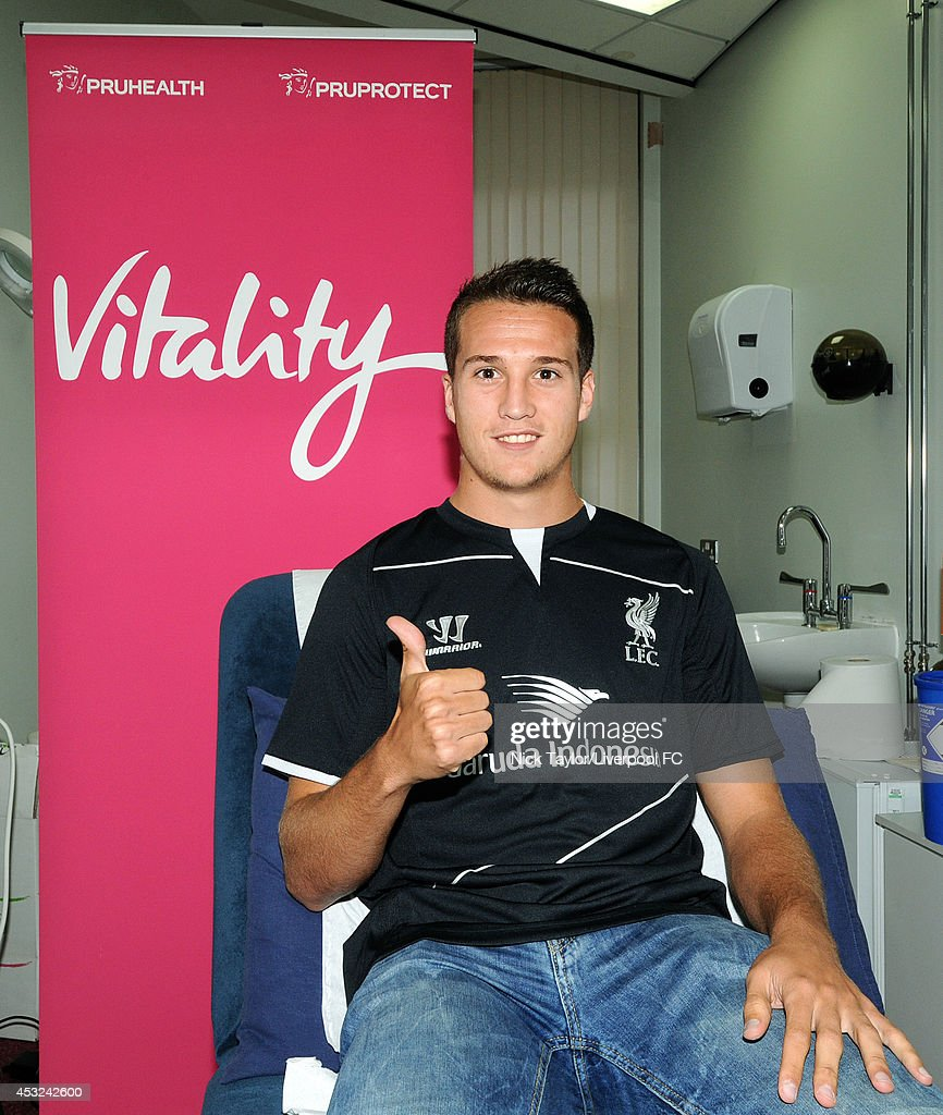 (MINIMUM FEES APPLY - GBP 150 FOR PRINT USE, GBP 75 ONLINE OR LOCAL EQUIVALENT, PER IMAGE) Javier Manquillo poses as he is unveiled as a new signing for Liverpool Football Club at Melwood Training Ground on August 5, 2014 in Liverpool, England.
