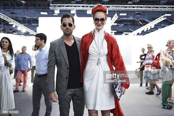 Javier Martin and Crazy Rouge seen wearing a vintage dress and coat and a headpiece from Hong Kong pose at Art Basel Miami Beach at the Miami Beach...