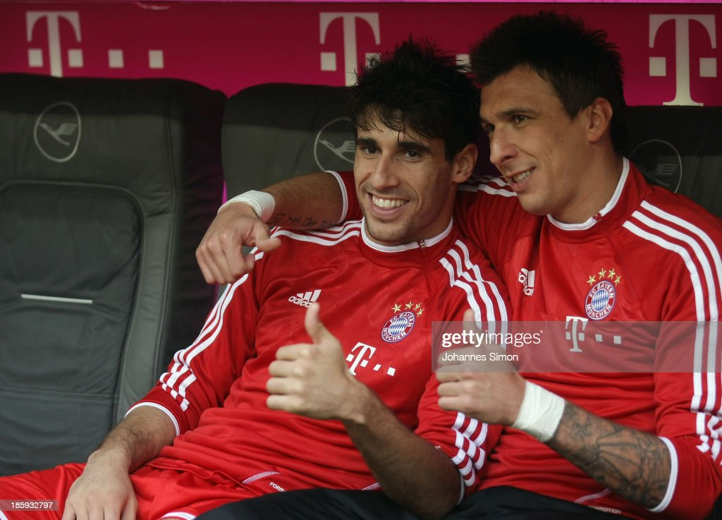 Javier Martinez (L) and <a gi-track='captionPersonalityLinkClicked' href=/galleries/search?phrase=Mario+Mandzukic&family=editorial&specificpeople=4476149 ng-click='$event.stopPropagation()'>Mario Mandzukic</a> of Muenchen wait for the start of Bundesliga match between FC Bayern Muenchen and Hertha BSC Berlin at Allianz Arena at Allianz Arena on October 26, 2013 in Munich, Germany.