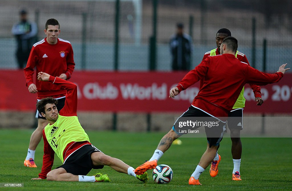 Javier Martinez dives for the ball during a Bayern Muenchen training session for the FIFA Club World Cup next to Agadir Stadium on December 16, 2013 in Agadir, Morocco.