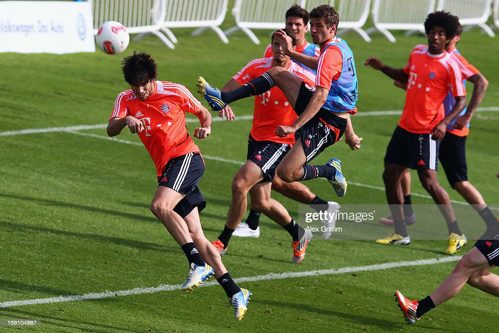 Javier Martinez (front) is challenged by Thomas Mueller during a Bayern Muenchen training session at the ASPIRE Academy for Sports Excellence on January 8, 2013 in Doha, Qatar.