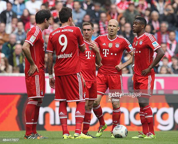 Javier Martinez Mario Mandzukic Philipp Lahm Arjen Robben and David Alaba of Bayern Muenchen chat before a free kick during the Bundesliga match...