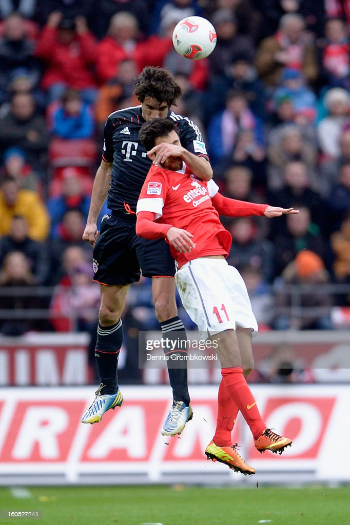 Javier Martinez of Bayern and Yunus Malli of Mainz go up for a header during the Bundesliga match between 1. FSV Mainz 05 and FC Bayern Muenchen at Coface Arena on February 2, 2013 in Mainz, Germany.
