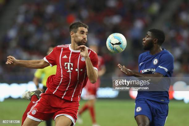 Javier Martinez of Bayern Muenchen battles for the ball with Jeremie Boga of Chelsea during the International Champions Cup 2017 match between Bayern...