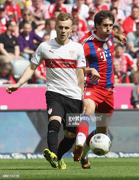 Javier Martinez of Bayern Muenchen fights for the ball with Alexandru Maxim of Stuttgart during the Bundesliga match between FC Bayern Muenchen and...