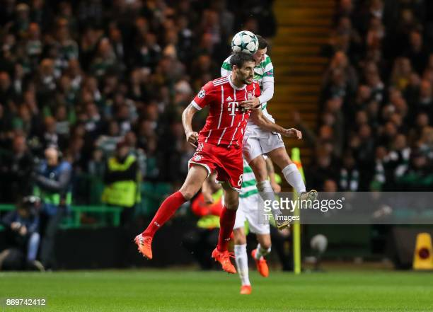 Javier Martinez of Bayern Munich and Callum McGregor of Celtic battle for the ball during the UEFA Champions League group B match between Celtic FC...