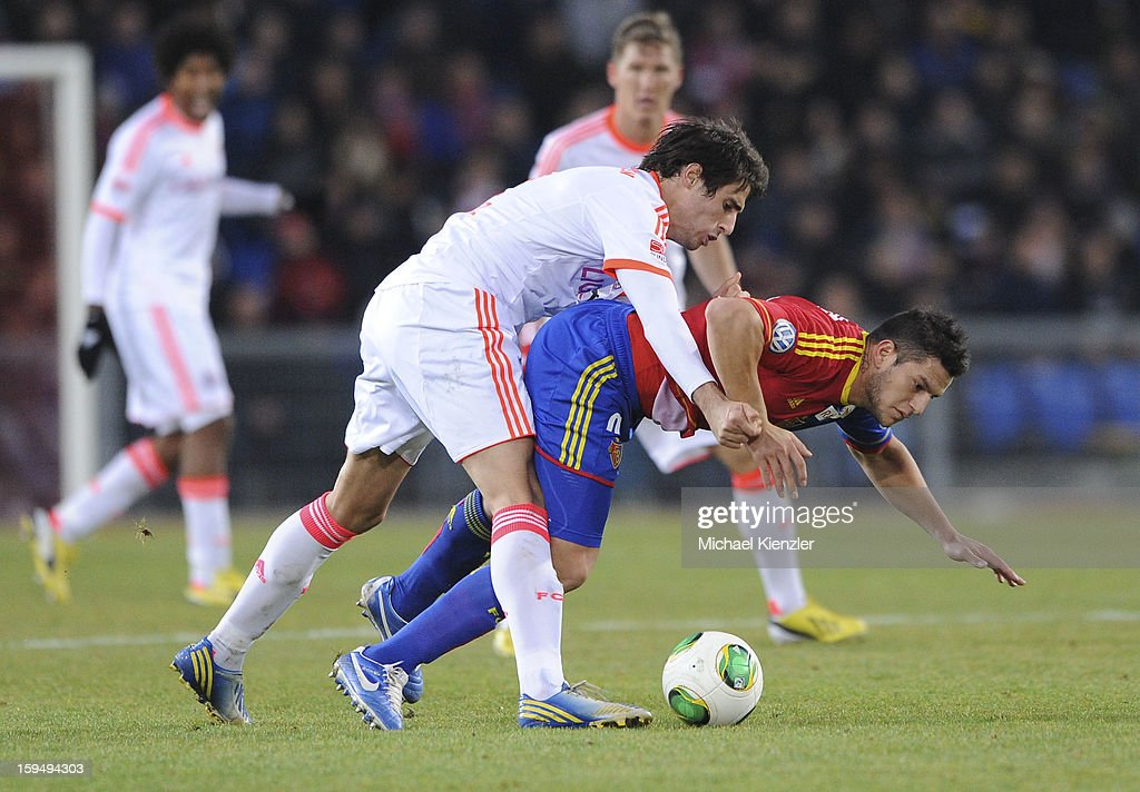 Javier Martinez (L) of Bayern Munich challenges <a gi-track='captionPersonalityLinkClicked' href=/galleries/search?phrase=Raul+Bobadilla&family=editorial&specificpeople=5967534 ng-click='$event.stopPropagation()'>Raul Bobadilla</a> during the friendly match between FC Basel and Bayern Munich at Stadium St. Jakob on January 12, 2013 in Basel, Switzerland.