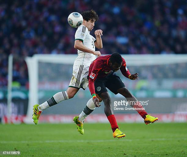 Javier Martinez of FC Bayern Muenchen and Mame Diouf of Hannover 96 go up for a header during the Bundesliga match between Hannover 96 and FC Bayern...
