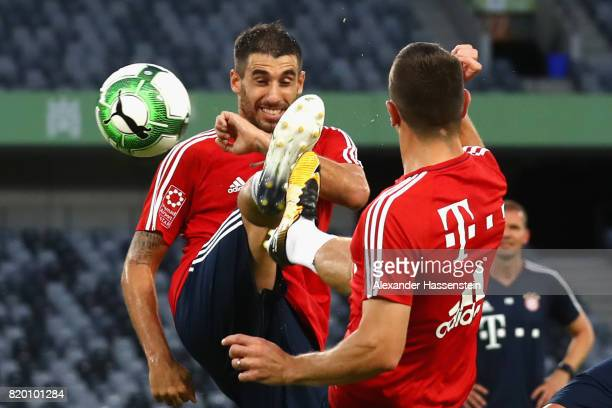 Javier Martinez of FC Bayern Muenchen battles for the ball with his team mate Rafinha during a training session at Shenzhen Universiade Sports Centre...