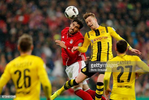 Javier Martinez of Muenchen and Marco Reus of Dortmund head for the bal during the DFB Cup semi final match between FC Bayern Muenchen and Borussia...