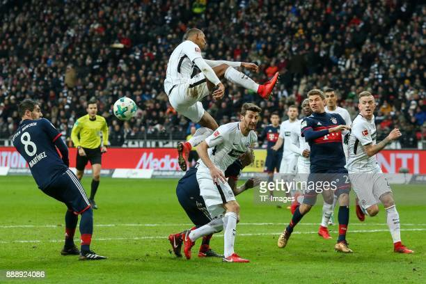 Javier Martinez of Muenchen and Sebastien Haller of Frankfurt battle for the ball during the Bundesliga match between Eintracht Frankfurt and FC...