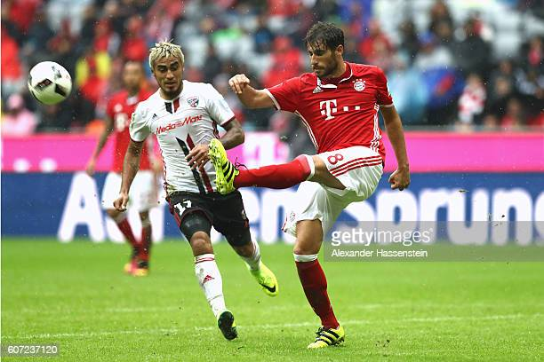 Javier Martinez of Muenchen battles for the ball with Dario Lazcano Farina of Ingolstadt during the Bundesliga match between Bayern Muenchen and FC...