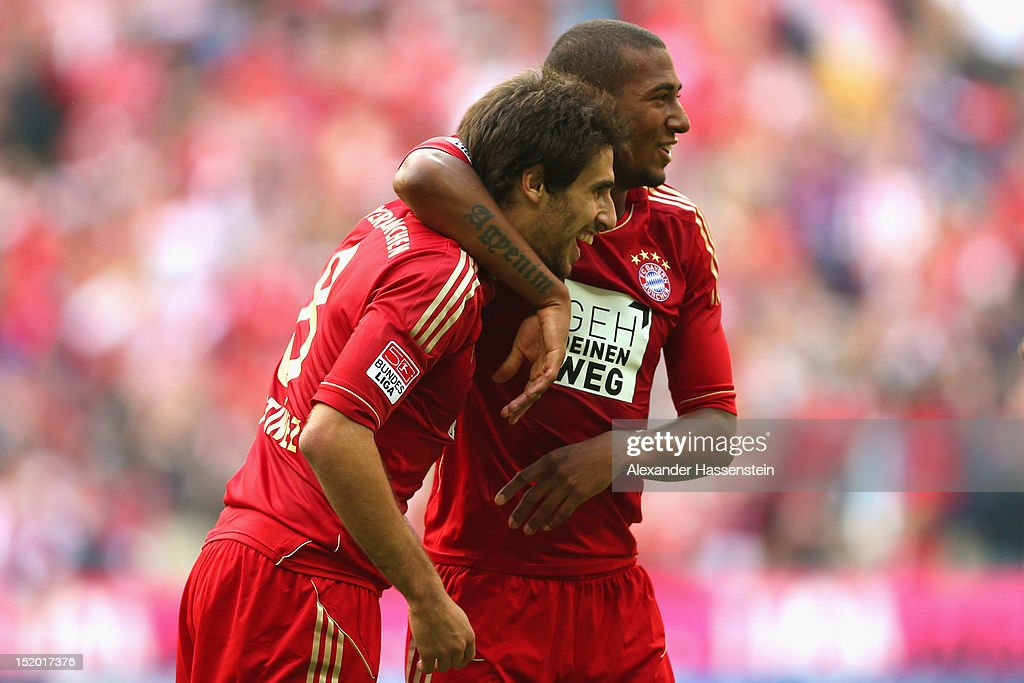 Javier Martinez (L) of Muenchen celebrates the 3rd team goal with his team mate <a gi-track='captionPersonalityLinkClicked' href=/galleries/search?phrase=Jerome+Boateng&family=editorial&specificpeople=2192287 ng-click='$event.stopPropagation()'>Jerome Boateng</a> during the Bundesliga match between FC Bayern Muenchen and 1. FSV Mainz 05 at Allianz Arena on September 15, 2012 in Munich, Germany.