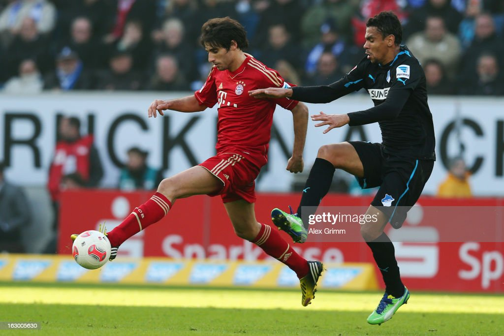 Javier Martinez (L) of Muenchen is challenged by <a gi-track='captionPersonalityLinkClicked' href=/galleries/search?phrase=Igor+de+Camargo&family=editorial&specificpeople=2514599 ng-click='$event.stopPropagation()'>Igor de Camargo</a> of Hoffenheim during the Bundesliga match between TSG 1899 Hoffenheim and FC Bayern Muenchen at Rhein-Neckar-Arena on March 3, 2013 in Sinsheim, Germany.