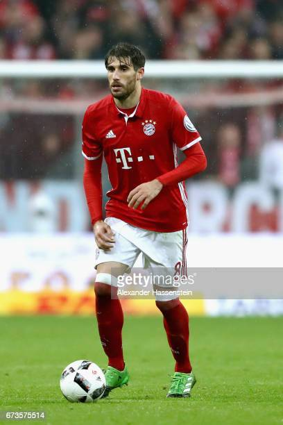 Javier Martinez of Muenchen runs with the ball during the DFB Cup semi final match between FC Bayern Muenchen and Borussia Dortmund at Allianz Arena...