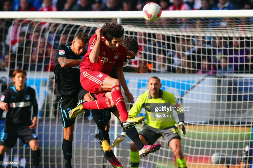 Javier Martinez (front) of Muenchen tries to score with a header against <a gi-track='captionPersonalityLinkClicked' href=/galleries/search?phrase=Fabian+Johnson&family=editorial&specificpeople=677415 ng-click='$event.stopPropagation()'>Fabian Johnson</a> (C) and Daniel Williams of Hoffenheim during the Bundesliga match between TSG 1899 Hoffenheim and FC Bayern Muenchen at Rhein-Neckar-Arena on March 3, 2013 in Sinsheim, Germany.