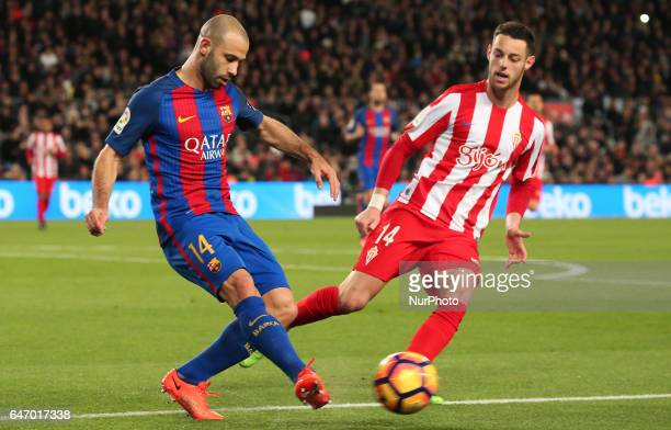 Javier Mascherano and Burgui during La Liga match between FC Barcelona v Sporting de Gijion in Barcelona on march 01 2017