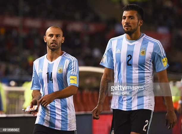 Javier Mascherano and Ezequiel Garay of Argentina leave the field at halftime during a match between Argentina and Ecuador as part of FIFA 2018 World...