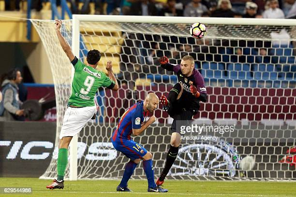 Javier Mascherano and Jasper Cillessen of Barcelona in action against Omar Al Soma during a friendly soccer match between AlAhli Saudi and Barcelona...